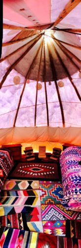 Tipi's have comfortable beds, fridges and air con/heating as well as decorative lighting