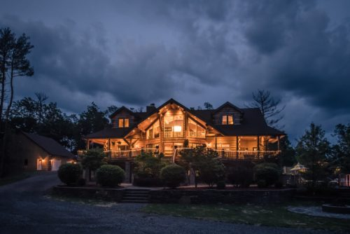 The log cabin exudes warmth in the evenings
